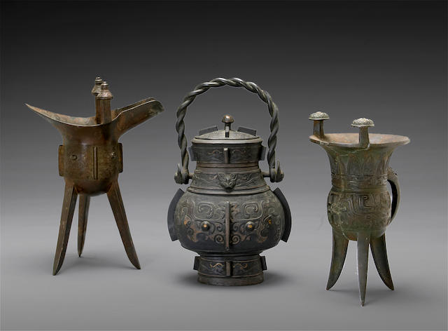 A group of three archaistic bronzes