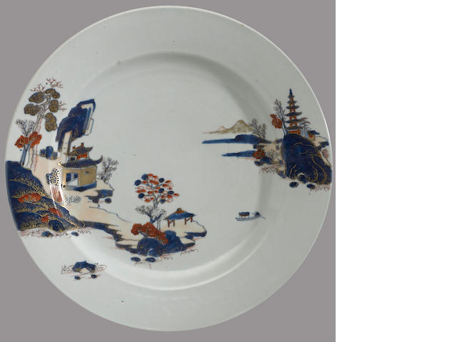 A pair of export porcelain chargers with underglaze blue and polychrome enamel decoration Qianlong period