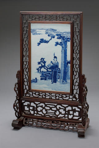 A blue and white porcelain rectangular plaque mounted in a mixed wood table screen