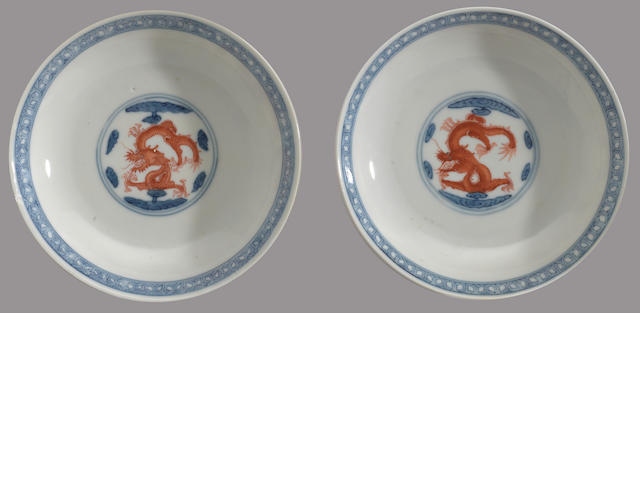A pair of blue and white porcelain saucers with iron red dragon decoration 19th century