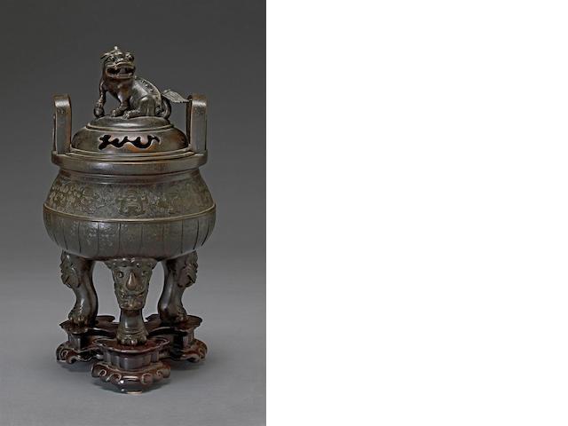 An archaistic bronze tripod censer