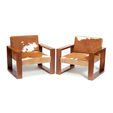A pair of Phase Design walnut and animal hide armchairs