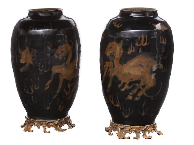 A pair of Chinese black and gold urns