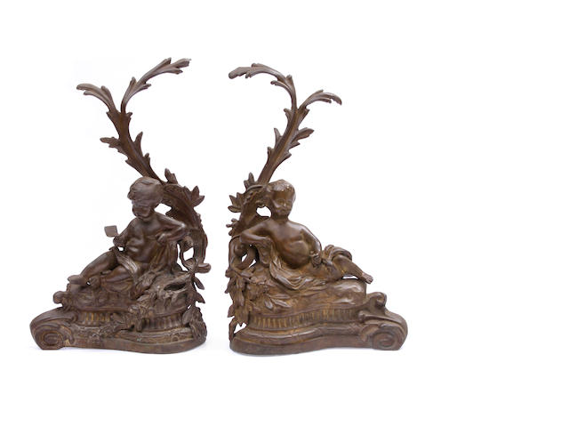 A pair of Louis XV style patinated bronze chenets
