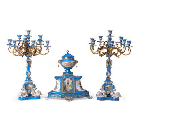 A Louis XV style gilt metal mounted porcelain clock garniture
