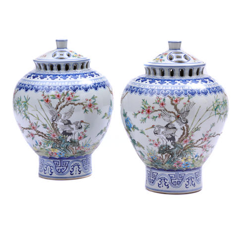 A pair of Chinese porcelain covered potpurri urns