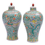 A pair of Chinese famille verte covered vases