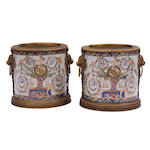 A pair of Neoclassical style gilt metal mounted porcelain jardinieres