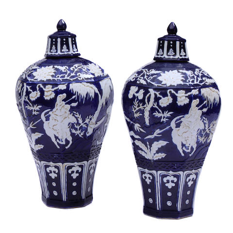 A pair of Chinese cobalt ground covered vases