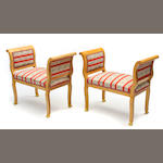 A pair of Empire style upholstered window benches
