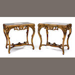 A pair of Louis XV style giltwood and porcelain tables