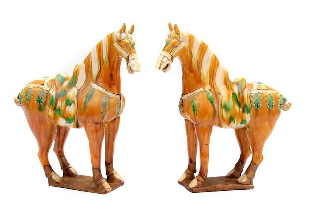 A pair of Chinese Tang style glazed earthenware models of horses