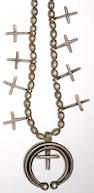 A Navajo or Pueblo cross necklace