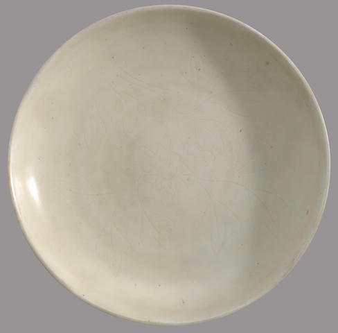 A white glazed porcelain dish with incised decoration 17th/18th century
