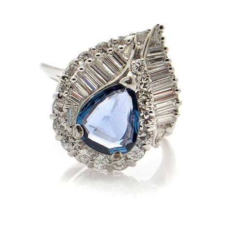 A sapphire, diamond and 18k white gold ring