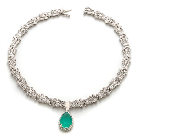 An emerald, diamond and 18k white gold pendant-necklace