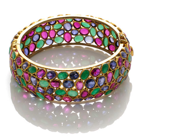A multi-colored gem-set and 18k gold bangle
