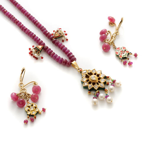A ruby bead, enamel, seed pearl and gold double strand necklace with a pair of matching earrings