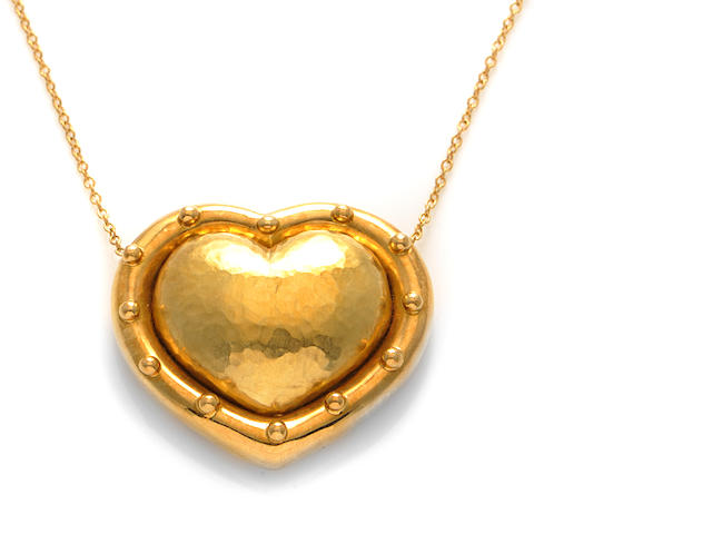 An 18k gold heart pendant and chain,