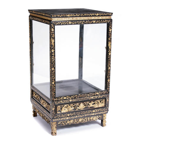 A Chinese parcel gilt ebonized display cabinet