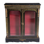 A Napoleon III ebonized and Boulle display cabinet