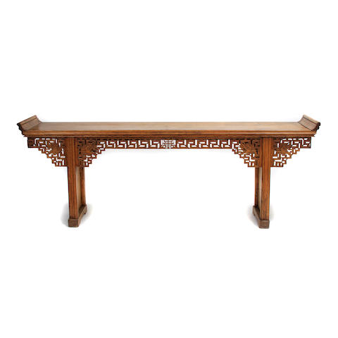 A Chinese carved and reticulated altar table