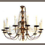 An Italian Neoclassical style giltwood, patinated metal and glass twelve light chandelier