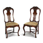 A pair of Portuguese Rococo style carved mahogany side chairs
