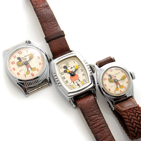 A collection of three steel strap wristwatches