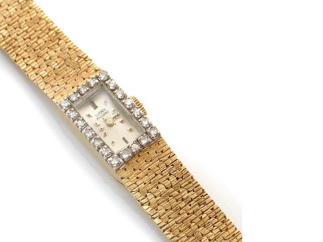 A diamond and 14k gold bracelet wristwatch, Lucien Piccard