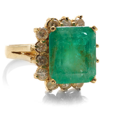 An emerald, diamond and 14k gold ring