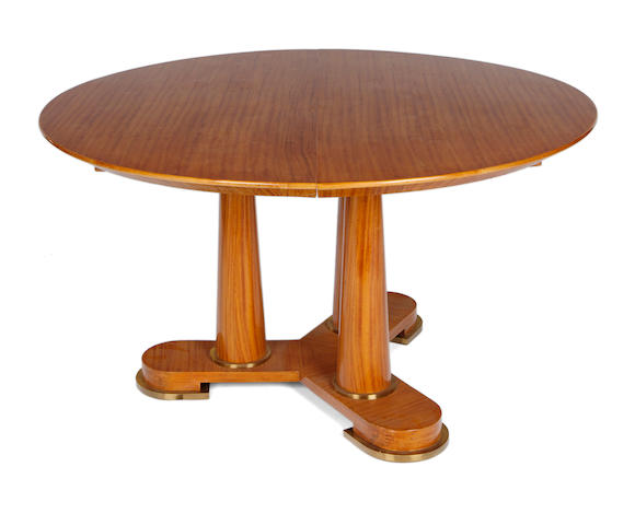 A large French Art Deco ormolu-mounted satinwood dining table in the manner of Jules Leleu, 1935