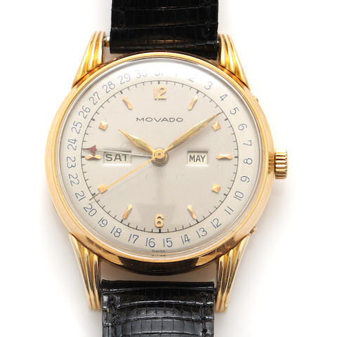 An 18k gold strap triple date wristwatch, Movado