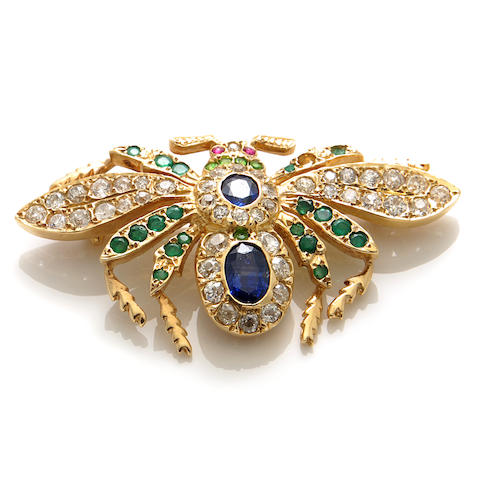 A diamond, gem-set and gold insect brooch