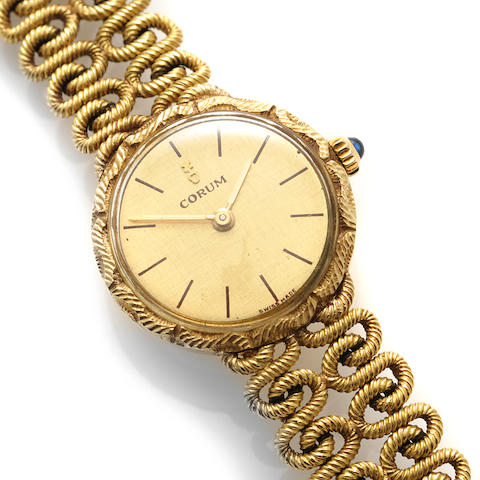 An 18k gold bracelet wristwatch, Corum