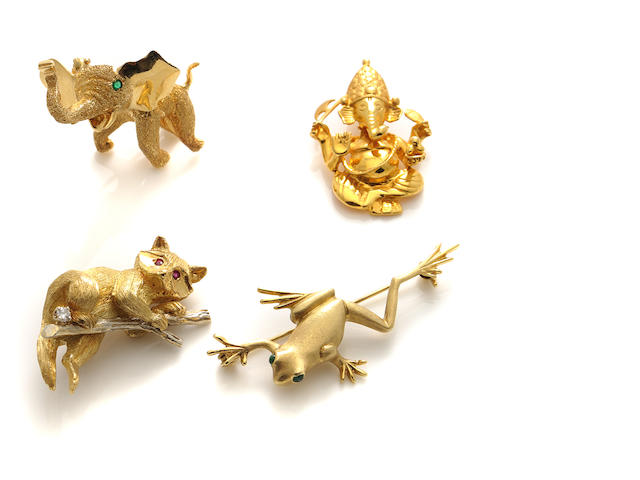 A group of three gem-set and gold animal brooches together with a 22k gold Ganesh pendant