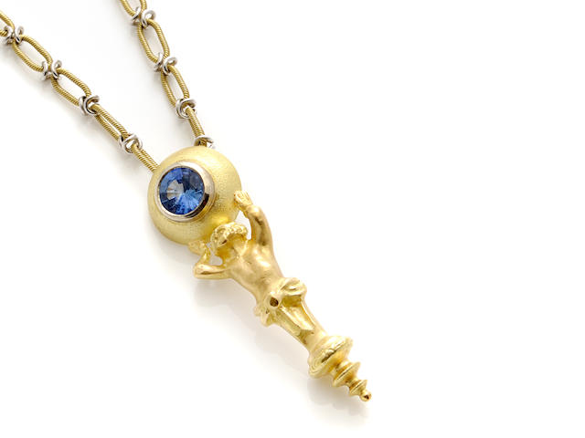 A blue stone and gold figural pendant together with a bicolor gold chain necklace