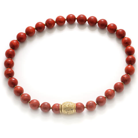A red bead and gold necklace
