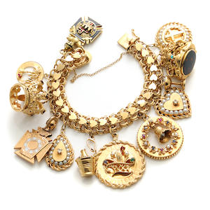 A 14k gold and gem-set charm bracelet