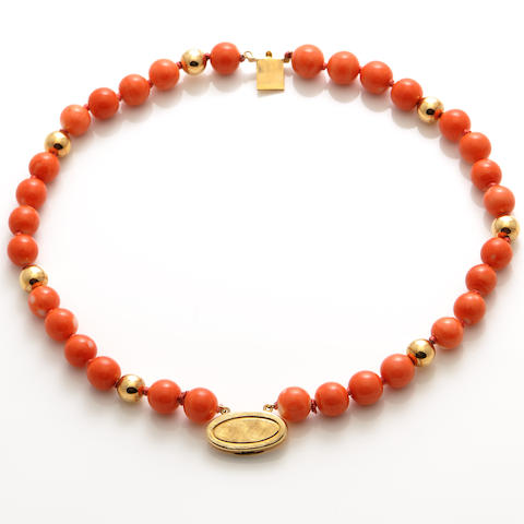 A coral and gold bead double row bracelet,