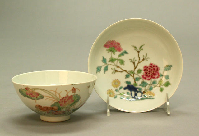 A group of four famille rose enameled porcelain containers