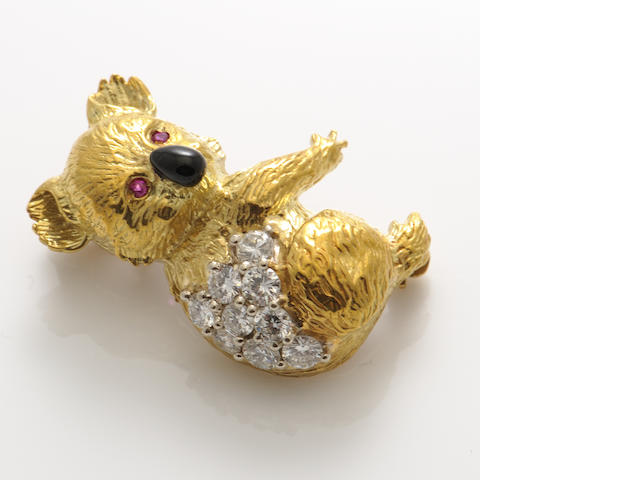 An enamel, diamond, ruby and gold koala pin-pendant