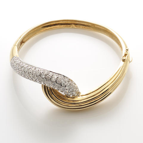 A diamond and bicolor gold bypass bracelet