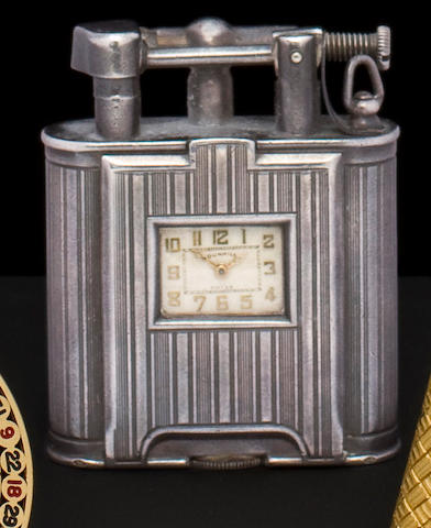 Dunhill. A sterling silver cigarette lighter with watchSecond quarter 20th century