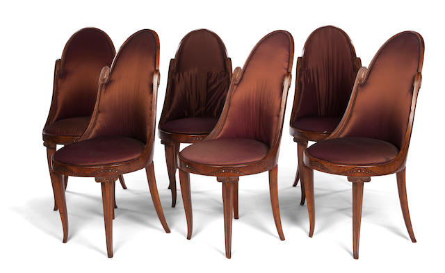 A set of six Maurice Dufrene fruitwood marquetry-inlaid and parcel ebonized wood dining chairs  circa 1920