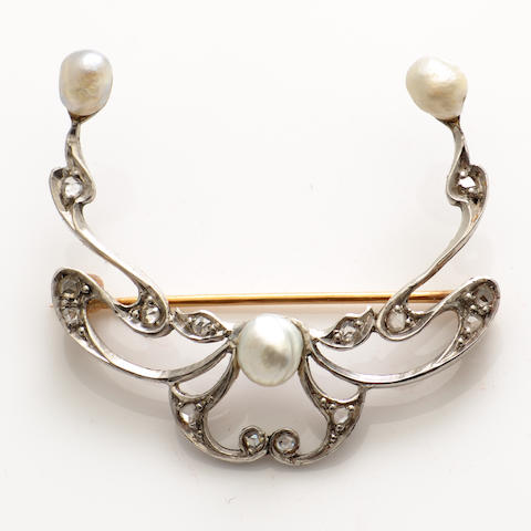 A diamond, cultured pearl and platinum topped gold brooch