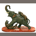 A large patinated bronze elephant and tiger group<BR />Meiji period