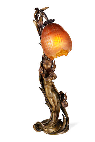 An Art Nouveau gilt-bronze and Daum Nancy glass figural lamp circa 1900
