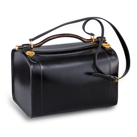 A black leather toiletry case, Hermès,