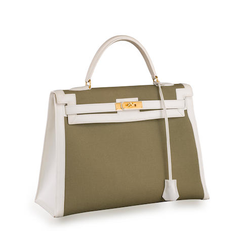 A white leather and olive canvas 'Kelly' handbag, Hermès,